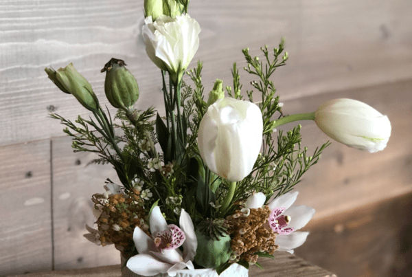 For the garden lover. Concrete bowl with gold accents to be styled and used as a table centerpiece. Includes: French garden rose, blush miniature cluster garden roses, anemones, lisianthus with lush greens.