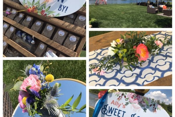 "Custom signage + photo booth at a tented lakeside party with bright florals and coordinating linens creating  the ""wow factor"""